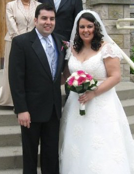 A picture containing person, wedding, standing, suit  Description automatically generated